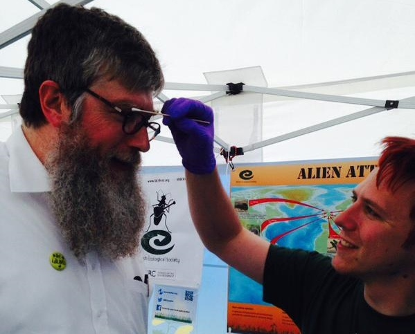 Member Phil Donkersley engaging with a festival goer.